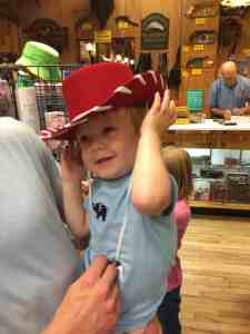 My cute little cowpoke trying on a cowboy hat at one of the shops in Wall Drug