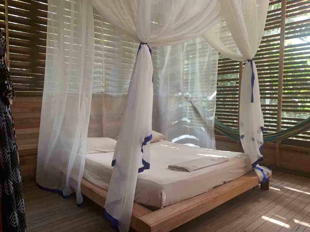 Photos of the Amazon: A bed with a mosquito net at a commune about 20 minutes outside of Leticia, Amazonas, Colombia—in the heart of the rainforest