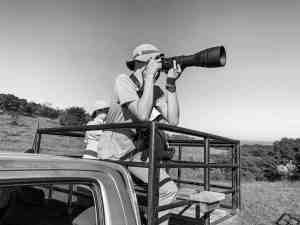 Matthias taking pictures of birds at Enonkishu Conservancy in the Maasai Mara, Kenya