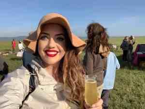 Enjoying champagne after landing the hot air balloon in the Maasai Mara