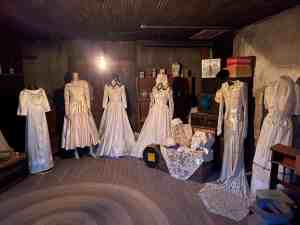 Old fashioned dresses in a dark room