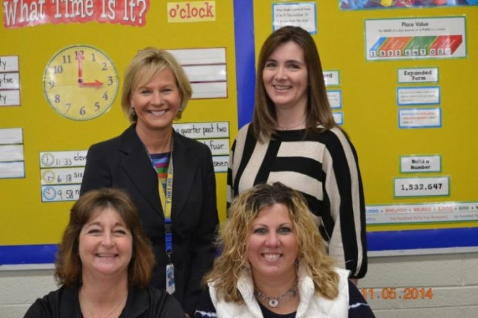 Back row: Dawn Green, superintendent and Christy Pruski, principal. Front row: Fran Kennon, math instructor third and fourth, and Mandi Taxis, instructional coach.