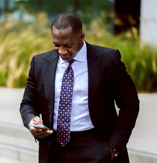attorney anthony ifediba (personal injury lawyer birmingham) looking at phone