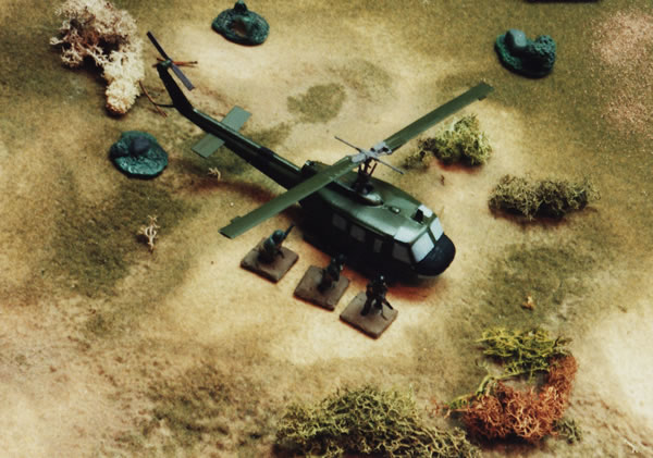 Huey lands to pick up a platoon in a Vietnam War demonstration game.