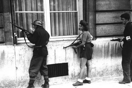 18 year old French Résistance fighter, Simone Segouin, patrolling Paris, 1944