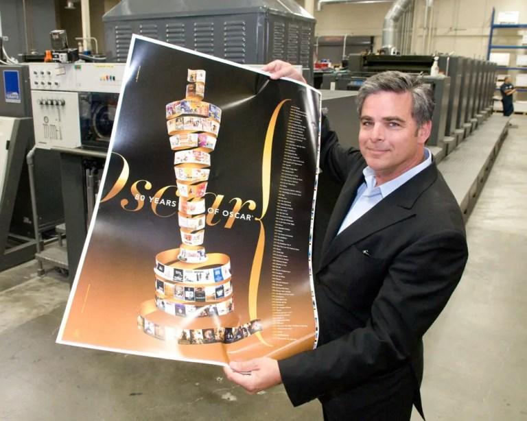 alex sawrt with his Oscar poster