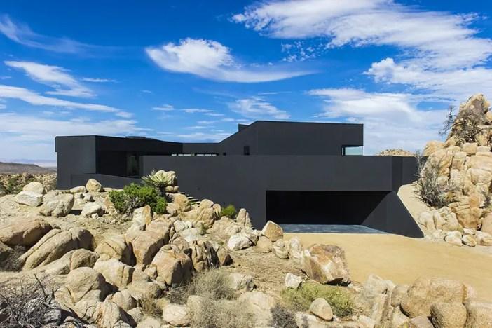 modern black house in the desert