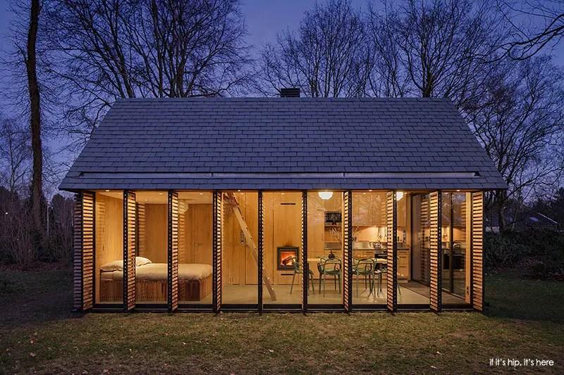 utrecht cabin by zecc architects shutters open evening