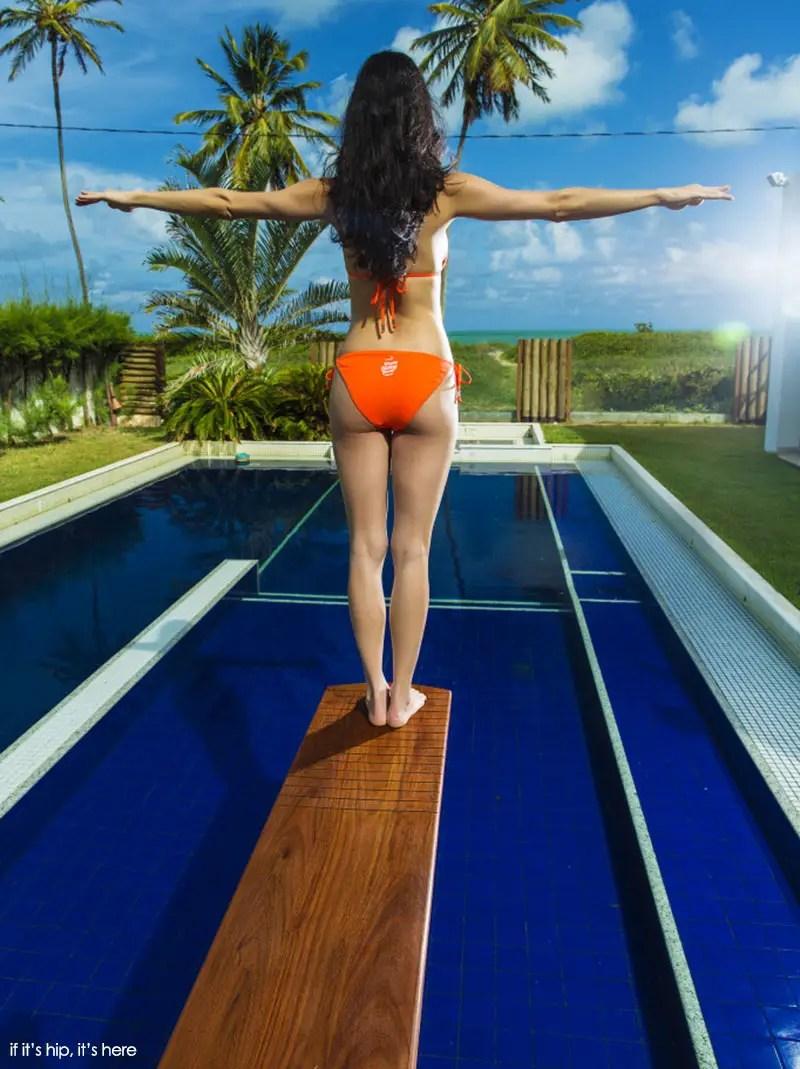 girl on revelation 1 board over pool
