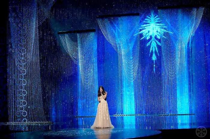 Idina Menzel performs with the Ice Palace Swarovski Crystal backdrop