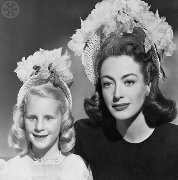Joan Crawford with her adopted daughter Christina in Easter Bonnets