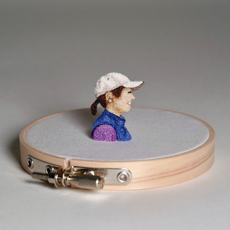 self portrait of the artist in embroidery