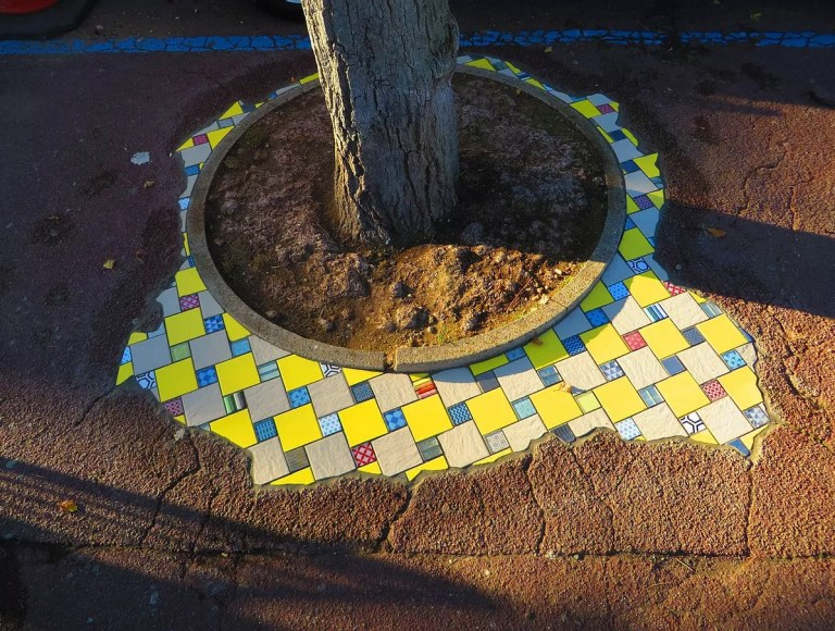 pothole repairs with art