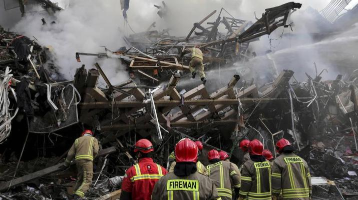 ifmat - 50 firefighters killed in Iran as burning high-rise collapses