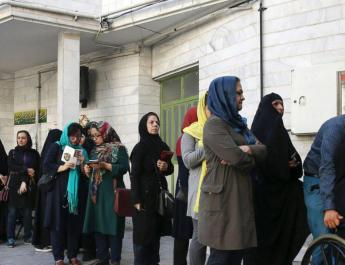 ifmat - Iran votes in first presidential election since nuclear deal