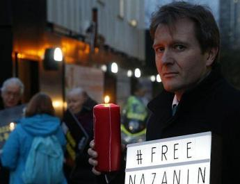 ifmat - UK protest for two citizens held in Iran
