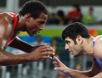 ifmat - Iran wrestler banned for losing to avoid Israel opponent