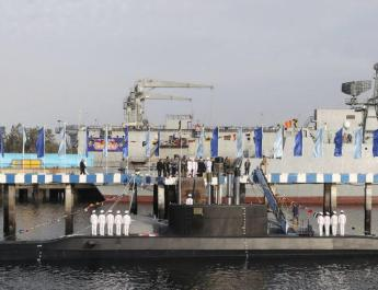 ifmat - Iran launches cruise missile from submarine during drill