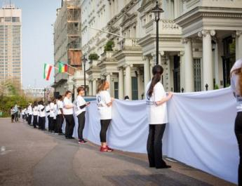 ifmat - Women are wearing white on Wednesday to protest Iranian strict hijab laws