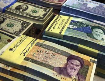 ifmat - Iran slashes four zeroes from rial currency over inflation