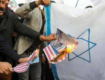 ifmat - Pro Iranian protesters target US embassy in Iraq