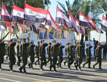 ifmat - In show of armed power pro-Iran factions hold parade in Iraq