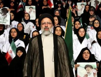 ifmat - Iran candidates spend third debate displaying infighting