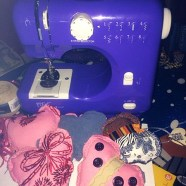 Teenager is busy sewing