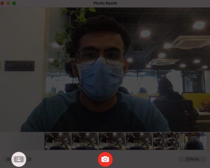 Щелкните значок камеры, чтобы сделать снимок с помощью Mac Photo Booth