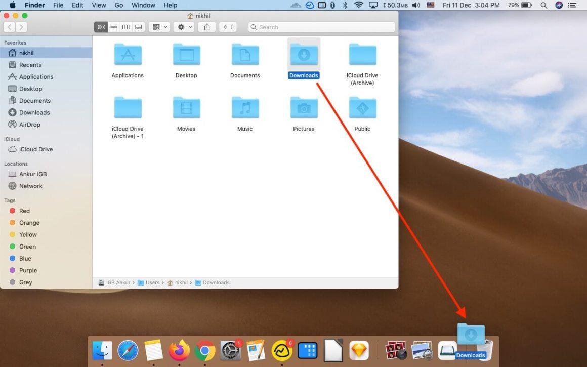Перетащите папку загрузок в док-станцию Mac