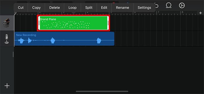 Дважды нажмите на зеленую аудиопанель и нажмите «Удалить» в приложении GarageBand на iPhone.
