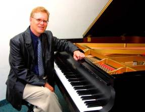 Dr Walden Hughes with his Piano