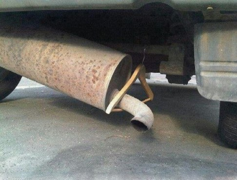 Jugaad for holding the Silencer pipe... Ironic and bravo. Source