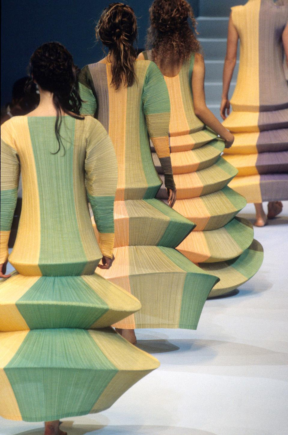 "Issey Miyake's ""Flying Saucer"" dress unveiled in 1994 was made entirely using machine sewing -indicating a clear presence of technology in fashion."