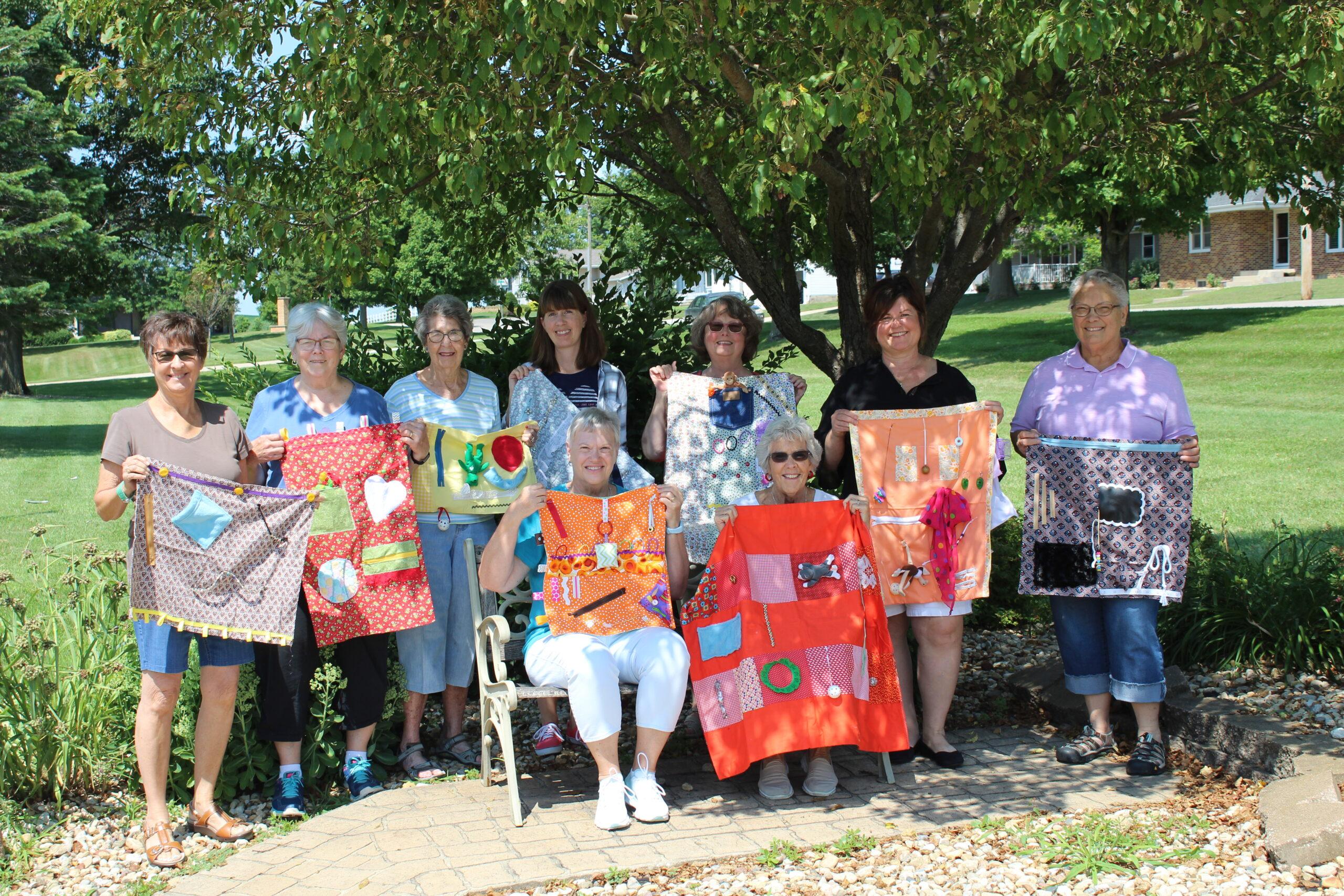 Volunteers create fidget blankets