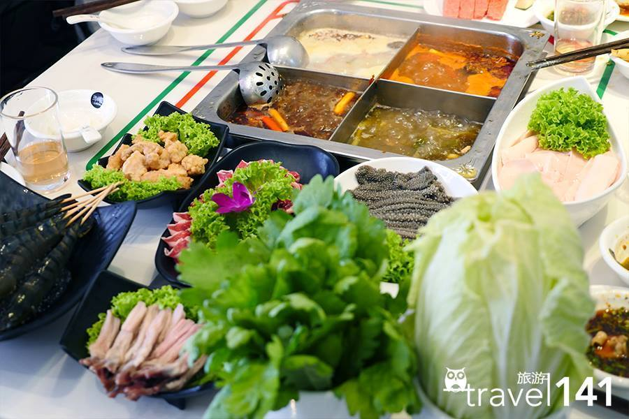 A hot pot meal by Xun Wei Hot Pot - Food photography by Travel141