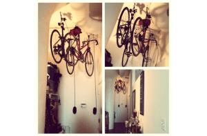 bikes hanging from pulley system on ceiling