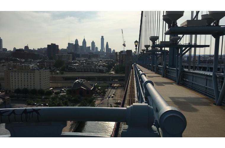 philadelphia skyline and walkway from the ben franklin bridge