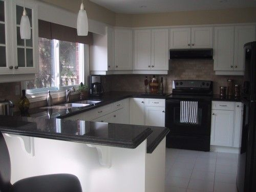 Kitchen Kitchens With Black Cabinets And Appliances Imposing On Kitchen Inside White Counter For The 7 Kitchens With Black Cabinets And Appliances Amazing On Kitchen What S The Best Appliance Finish For