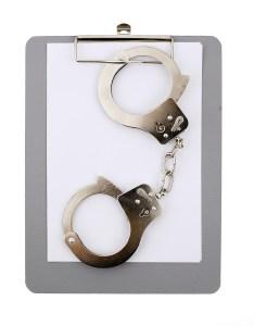 handcuff and empty clipboard