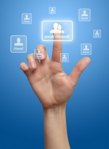 hand pressing Social network button, blue background