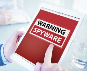 Hands Holding Digital Tablet Spyware