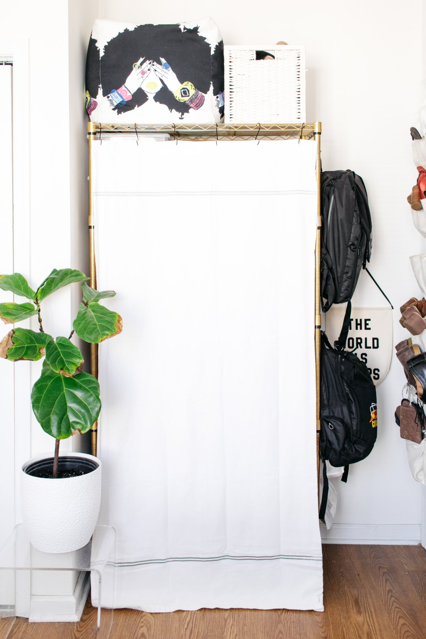 Home Office to Guest Bedroom Makeover - Hidden Wire Shelving with Shower Curtain
