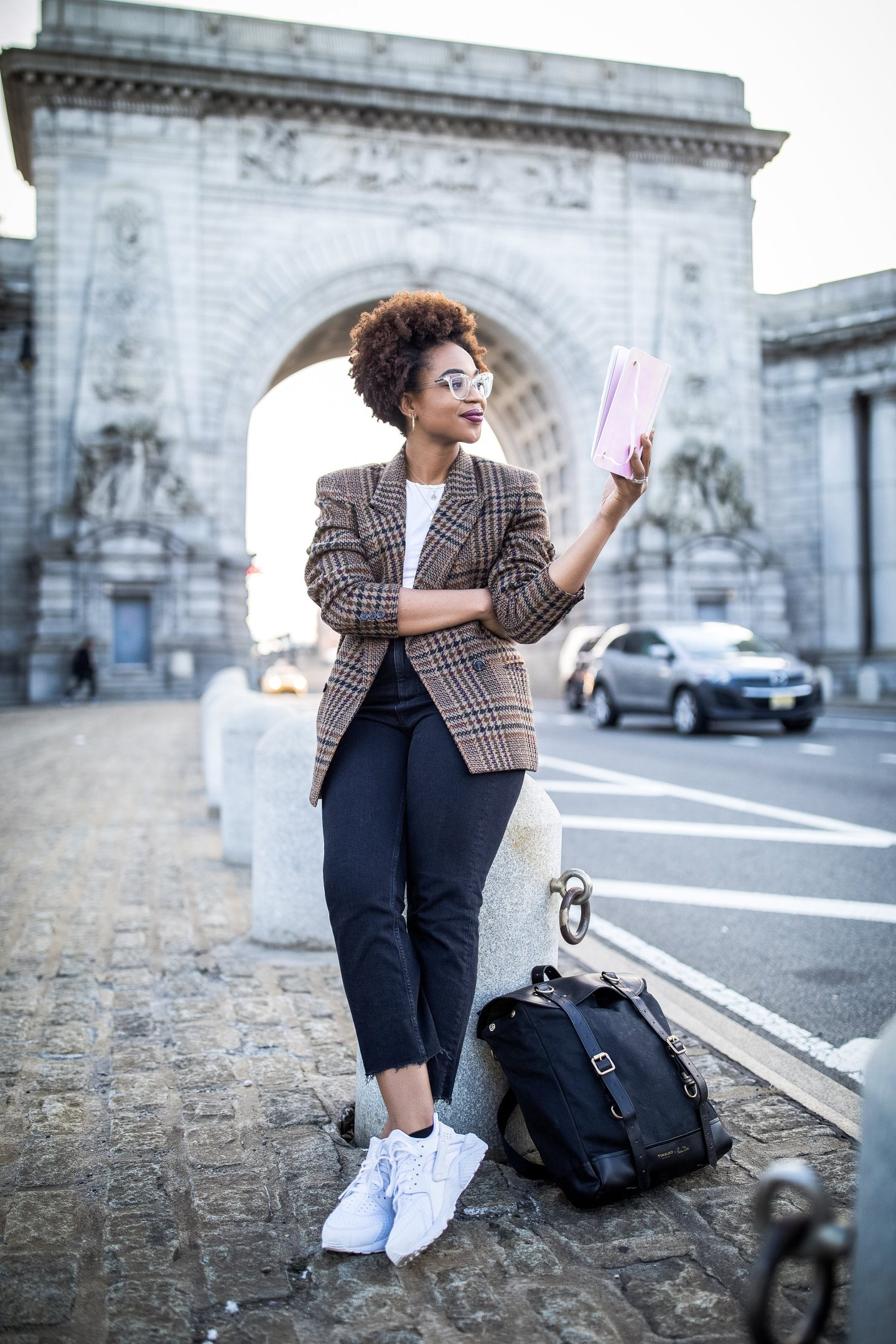 PhD student Ijeoma Kola with a planner, plaid blazer, nike huaraches all white, and timbuk2 jetset convertible travel backpack