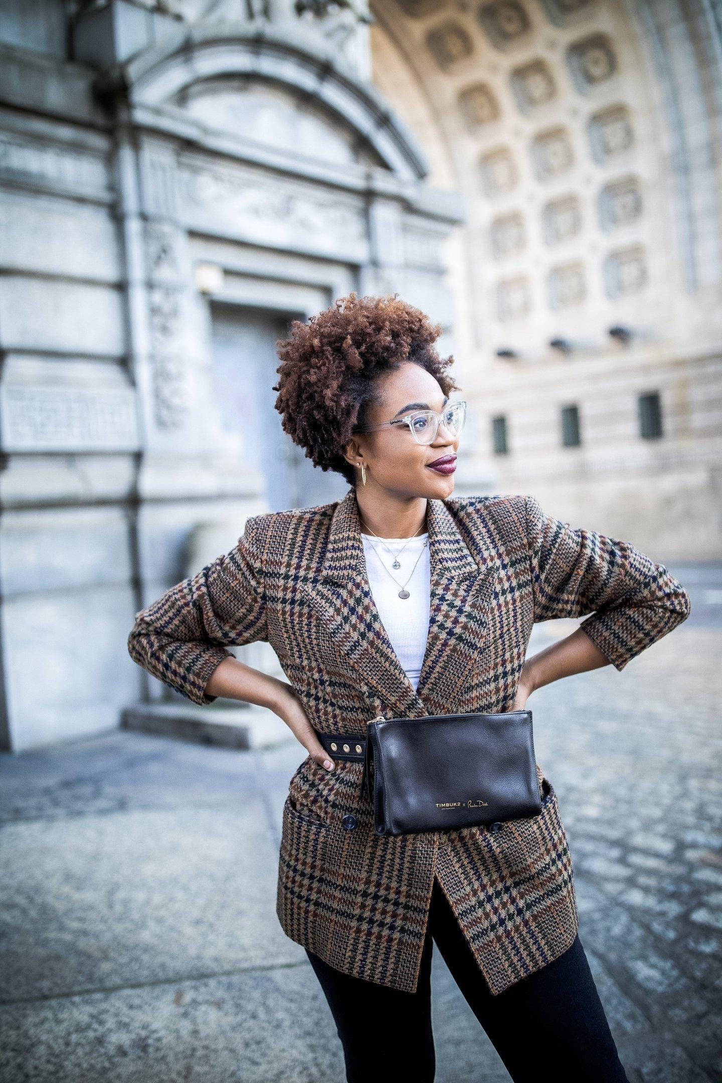 Lifestyle blogger Ijeoma Kola wears vintage Gucci blazer, belt bag, and burberry eyeglasses
