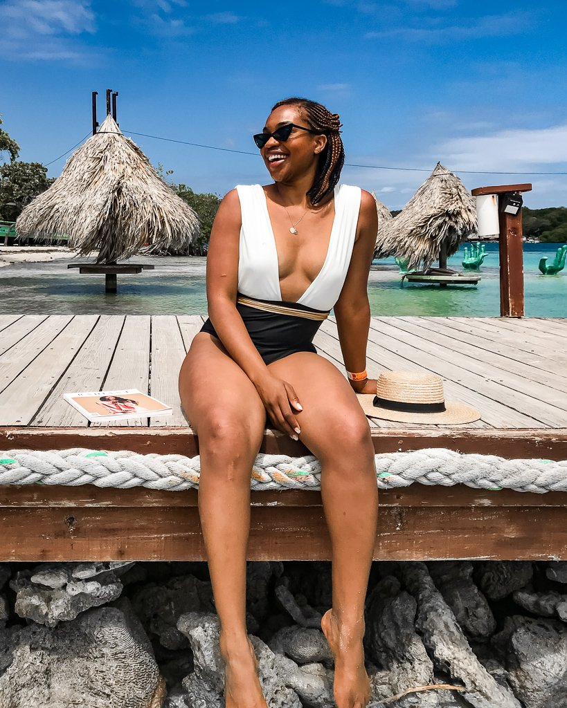 Ijeoma Kola wears Summersalt Capri swimsuit at Big French Key in French Harbor Roatan Honduras