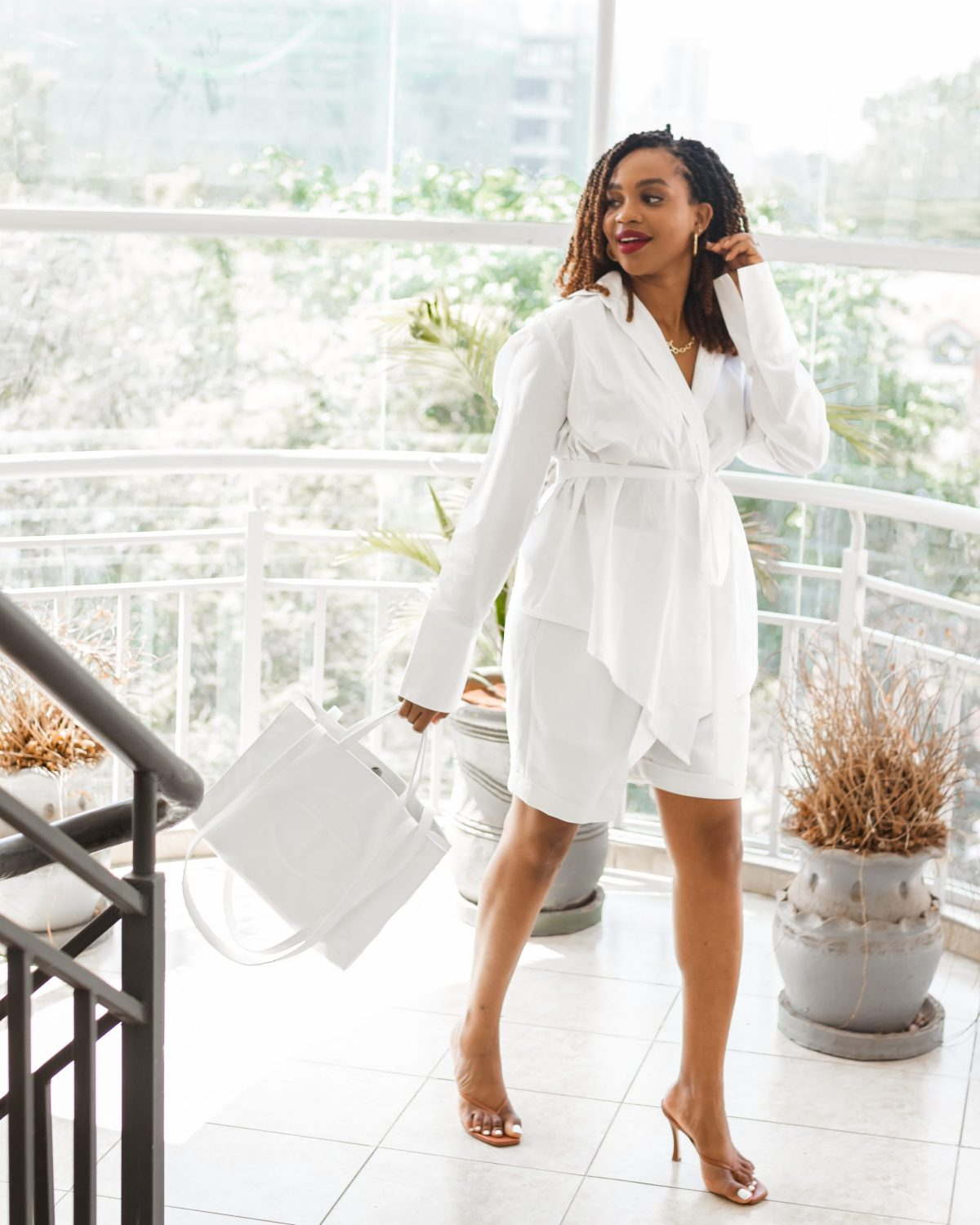 Ijeoma Kola in white wrap shirt and shorts
