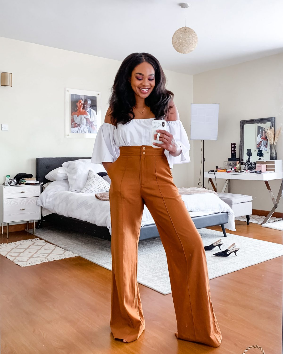 Ijeoma Kola in white top and linen pants