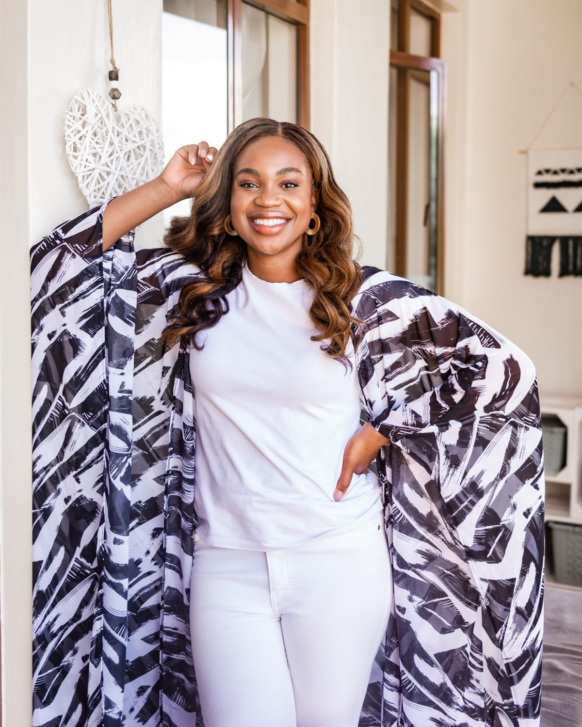 Ijeoma Kola in white outfit with black and white kimono