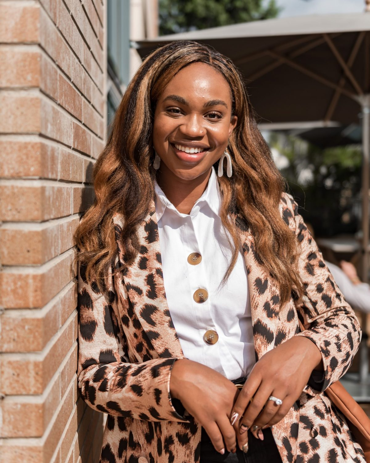 Ijeoma Kola in white shirt and animal print blazer - How to Grow Business